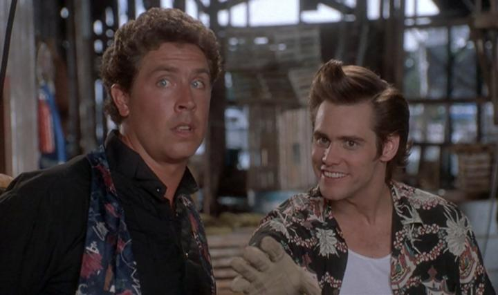 Jim Carrey and Dan Marino in Ace Ventura: Pet Detective (1994)