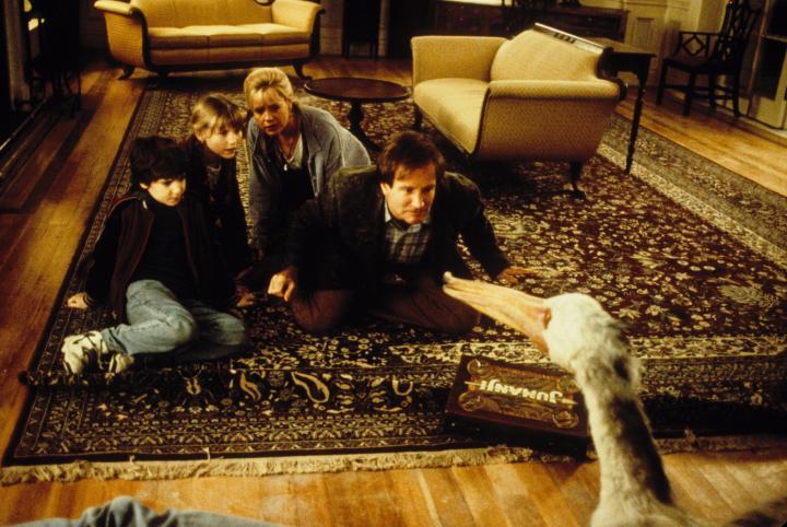 Robin Williams, Kirsten Dunst, Bonnie Hunt, and Bradley Pierce in Jumanji (1995)
