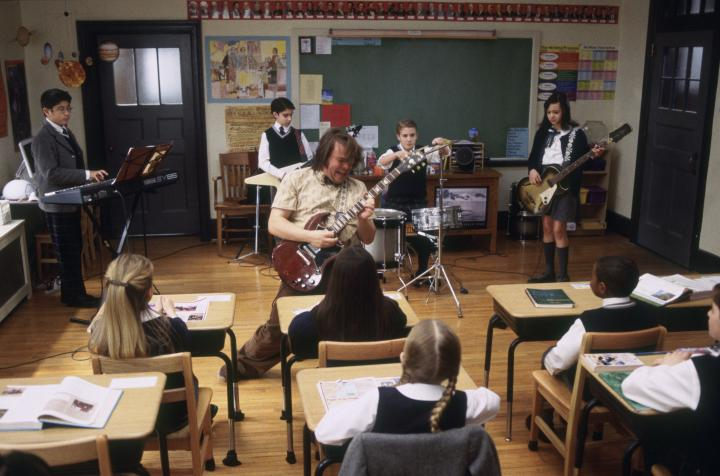 Jack Black and Robert Tsai in School of Rock (2003)