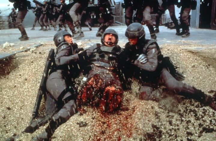 Michael Ironside, Dina Meyer, and Casper Van Dien in Starship Troopers (1997)