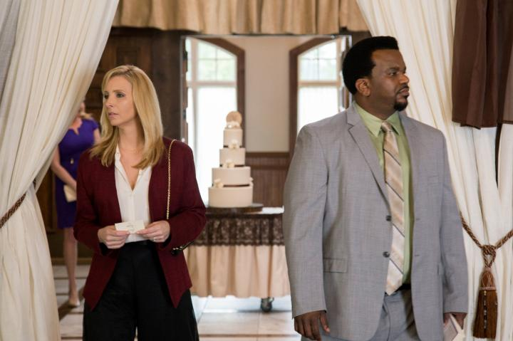 Lisa Kudrow and Craig Robinson in Table 19 (2017)
