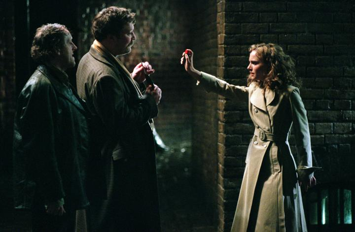 Natalie Portman, Ian Burfield, and Mark Phoenix in V for Vendetta (2005)